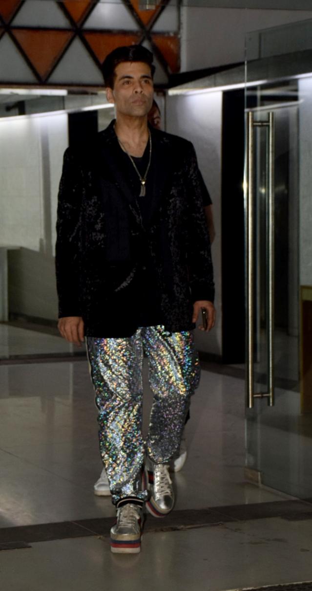Karan Johar makes an entrance in eye-catching pants.