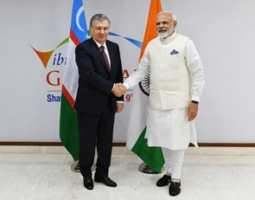 Gandhinagar: Prime Minister Narendra Modi meets Uzbekistan President Shavkat Mirziyoyev on the sidelines of the 9th Vibrant Gujarat Global Summit at Mahatma Mandir in Gandhinagar, Gujarat on Jan 18, 2019. (Photo: IANS/PIB)