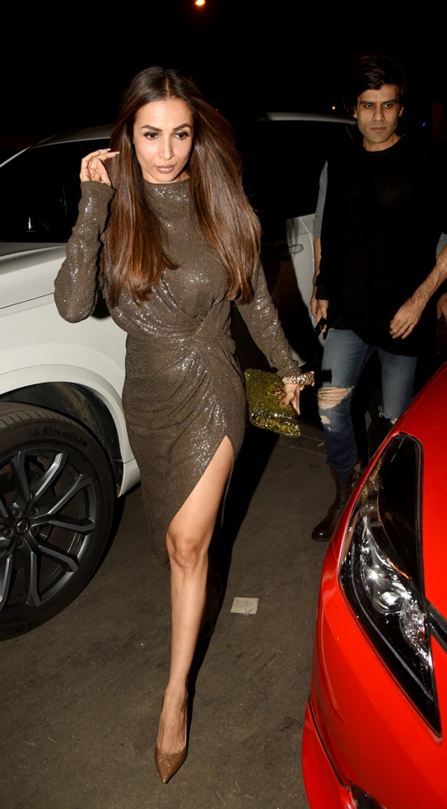 Malaika looks stunning in a sequinned wrap around dress.