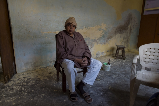 Krishna Kumar Sharma poses for a photograph while supervising renovation work in a house that he bought at Manduadih about five kilometres away from Lahori Tola.