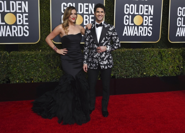 Mia Swier (left) and Darren Criss on the red carpet.