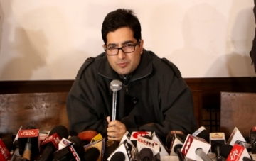 "Srinagar: Kashmiri IAS officer Shah Faesal, who quit IAS to protest against ""unabated killings"" in Jammu and Kashmir, addresses a press conference in Srinagar, on Jan 11, 2019. Faesal, the first Kashmiri IAS topper, resigned from the civil service on Wednesday and said he planned to enter politics. (Photo: IANS)"