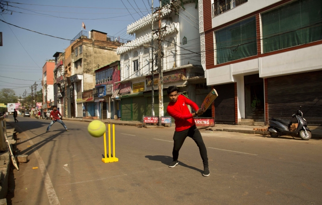 Boys play cricket on a deserted street during an eleven hour general strike called by All Assam Students' Union (AASU) and North East Students' Organisation (NESO) in Guwahati on Tuesday, 8 January, 2019.