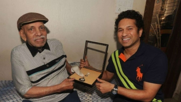 File photo of Sachin Tendulkar greeting his childhood coach Ramakant Achrekar.