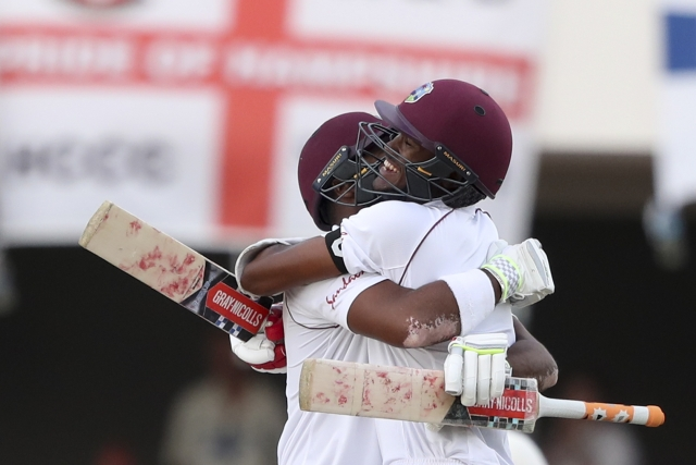 West Indies' John Campbell and Kraigg Brathwaite celebrate beating England by ten wickets on day three of the second Test cricket match at the Sir Vivian Richards Stadium in North Sound, Antigua and Barbuda, Saturday, Feb. 2, 2019.
