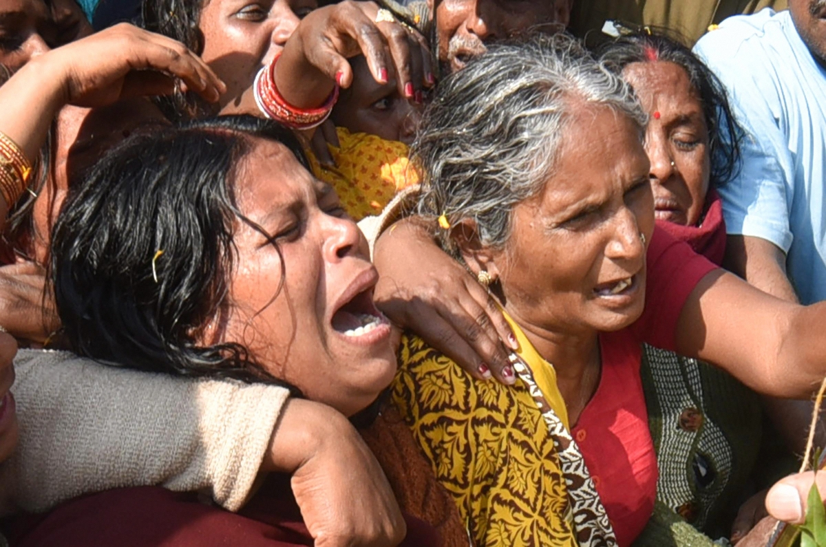Family members of slain CRPF Sanjay Kumar Singh cry during the funeral procession, at Masaurhi, in Patna.