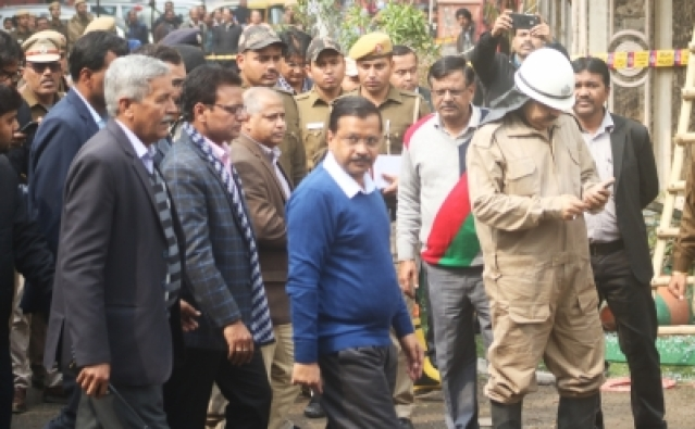 New Delhi: Delhi Chief Minister Arvind Kejriwal visit the site where a child and 16 others, including a woman was killed in a major fire  that engulfed several storeys of a central Delhi hotel on Feb. 12, 2019.(Photo: IANS)