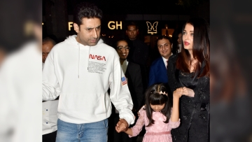 Abhishek and Aishwarya step out to celebrate Jr Bachchan's birthday.