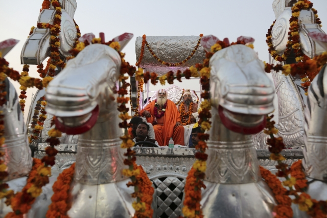 Sadhus participate in a procession towards the Sangam, the confluence of rivers Ganges and Yamuna, during the Kumbh Mela in Prayagraj.