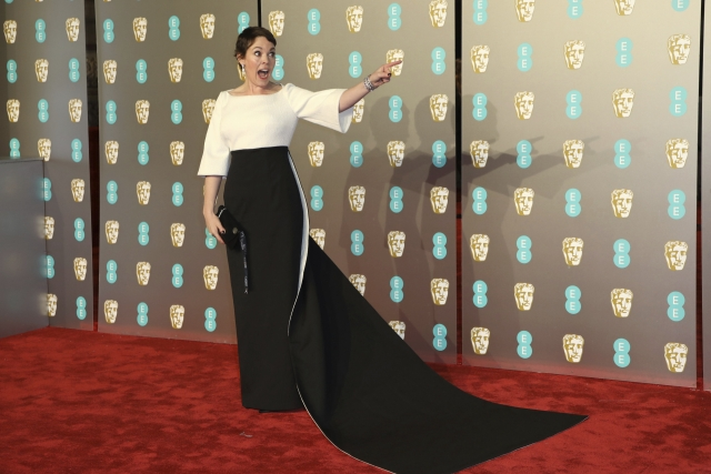 Olivia Colman gets goofy on the red carpet.