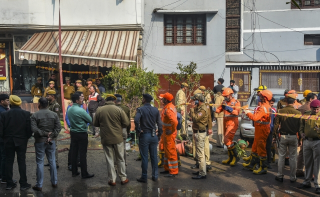 NDRF, firefighters and police officials seen at the site after a massive fire broke out at Karol Bagh's Arpit Palace hotel, in which at least 17 people were killed and several injured in New Delhi.