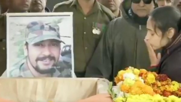 Martyred Major VS Dhoundiyal's wife, Nitika Kaul, seen next to his casket to bid her final goodbye.