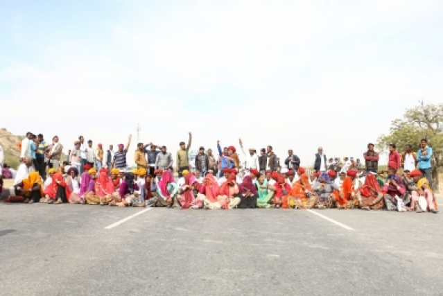 Ajmer: People belonging to Gujjar community stage a demonstration on National Highway (NH) 58 to demand five per cent reservation in jobs and educational institutions, in Ajmer, Rajasthan on Feb 10, 2019. (Photo: Shaukat Ahmed/IANS)