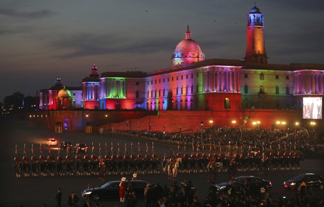 President Ram Nath Kovind's convoy leaves, escorted by horse-mounted presidential bodyguards, past the illuminated north and south blocks, at the end of the Beating Retreat ceremony on Tuesday, 29 January. The ceremony marks the end of the annual Republic Day festivities.