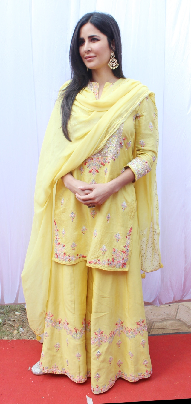 Katrina looks resplendent in a yellow ensemble.
