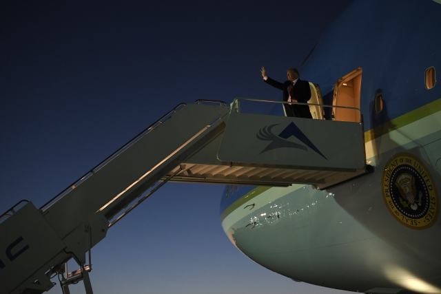 President Donald Trump walks down the steps of Air Force One at El Paso International Airport in El Paso, Texas, Monday, 11 February 2019.