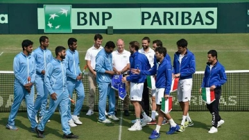 The Indian and Italian contingents greet each other ahead of their Davis Cup qualifier in Kolkata, which Italy won to go through to the Finals.