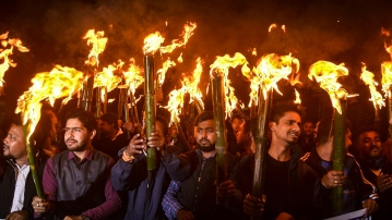 Activists of All Assam Students Union (AASU) and other organisations take part in a torch light rally procession to protest against the Citizenship (Amendment) Bill 2016, in Guwahati, Thursday, 31 January  2019.