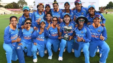 The Indian women's cricket team poses with the trophy after winning their three-match ODI series in New Zealand 2-1.