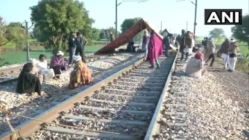 Visuals of the protest on the train tracks.