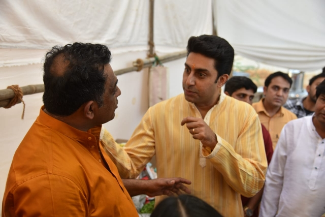 Abhishek Bachchan is engrossed in conversation with Anurag.
