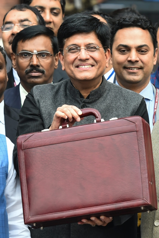 Finance Minister Piyush Goyal displays a briefcase containing the Union budget to be presented at the Parliament outside his North Block office in New Delhi on Friday, 1 February, 2019.