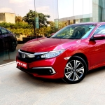 The Honda Civic has distinct coupe-like styling with the family look.