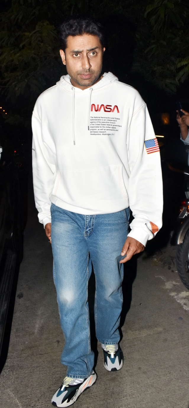 Abhishek Bachchan keeps it casual with a white sweatshirt.