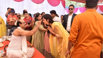 Katrina Kaif receives blessing from a pandit at Anurag Basu's Saraswati Puja.
