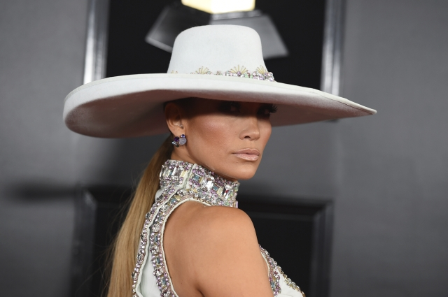 JLO arrived in a white hat and chunky silver bling.