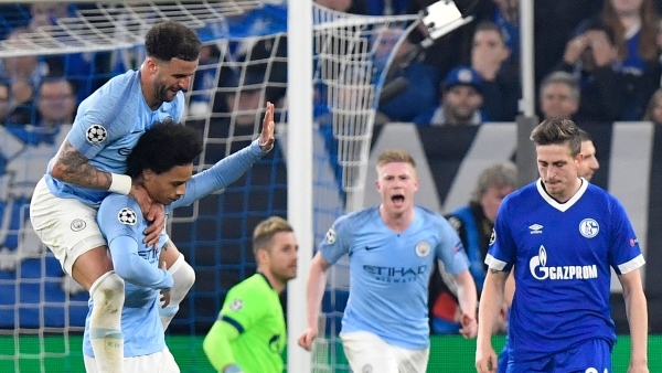 Leroy Sane (hand raised), a former Schalke player, reacts after scoring Manchester City's equaliser in the UEFA Champions League round of 16 first leg clash at Gelsenkirchen.