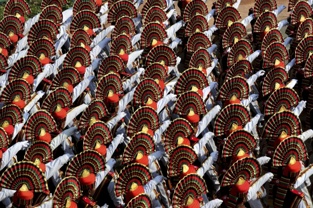 Indian Paramilitary soldiers march past Rajpath, the ceremonial boulevard, at the end of the Republic Day parade in New Delhi, India, Saturday, 26 January 2019. Thousands of Indians have converged on a ceremonial boulevard to watch a display of the country's military power and cultural diversity amid tight security during national day celebrations.