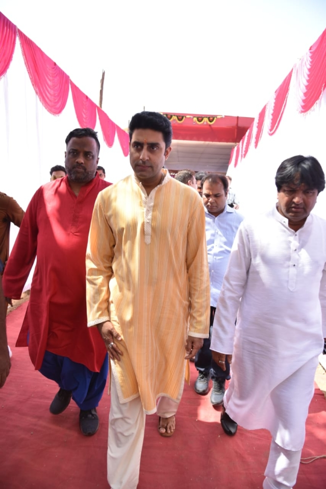 Abhishek Bachchan arrives at the venue in an orange kurta.