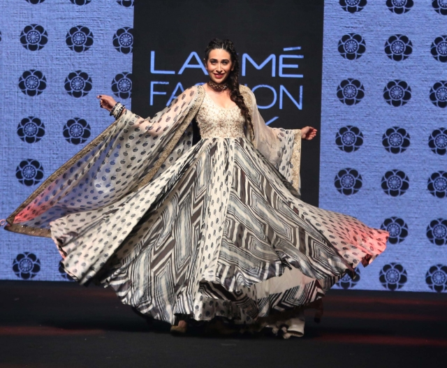 Karishma Kapoor twirls on the ramp.