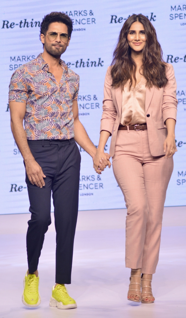 Shahid and Vaani pose for shutterbugs after doing the catwalk.