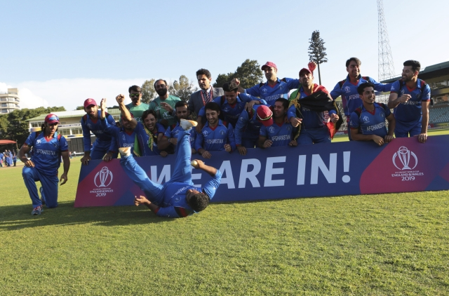 Afghanistan  players celebrate after beating Ireland  to qualify for the Cricket World Cup after their  match at Harare  Sports Club,  Friday, March, 23, 2018.