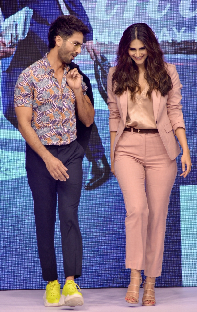 Shahid and Vaani share a joke while walking the ramp.