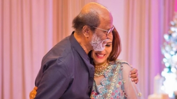 Rajinikanth shares a lovely moment with his daughter Soundarya.