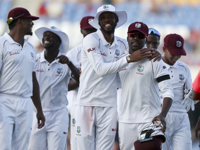 West Indies' Roston Chase and Darren Bravo embrace at the end of their second innings against England during day three of the second Test cricket match at the Sir Vivian Richards Stadium in North Sound, Antigua and Barbuda, Saturday, Feb. 2, 2019.
