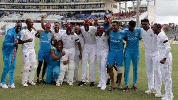 West Indies players celebrate beating England by ten wickets on day three of the second Test cricket match at the Sir Vivian Richards Stadium in North Sound, Antigua and Barbuda, Saturday, Feb. 2, 2019.