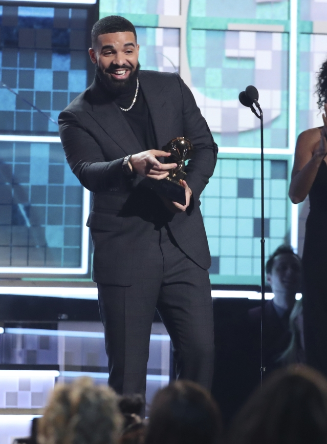 Drake accepts his Grammy for 'God's Plan'.