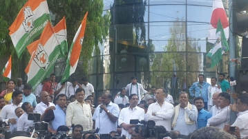 CM Kumaraswamy with senior coalition leaders outside the I-T office in Bengaluru.