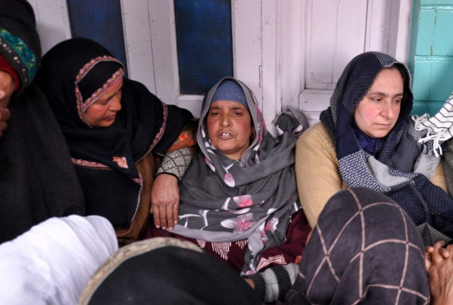 Relatives and neighbours consolling Rizwan's  mother.