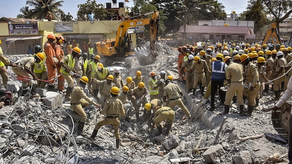 Rescue teams conduct operations after an under-construction building collapsed, at Dharwad in north Karnataka, Thursday, 21 March 2019.