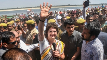 Congress General Secretary UP (East) Priyanka Gandhi Vadra waves to her party supporters at Assi Ghat, in Varanasi.