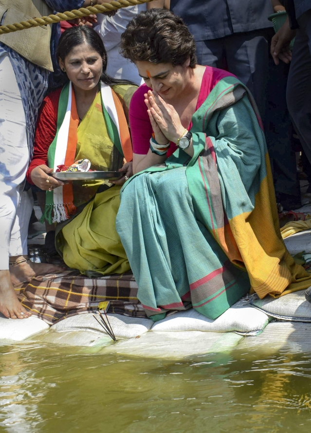 Congress General Secretary UP-East Priyanka Gandhi Vadra offers prayers at Triveni Sangam, to start 3-day long Ganga-yatra from Chhatnag in Prayagraj to Assi Ghat in Varanasi.