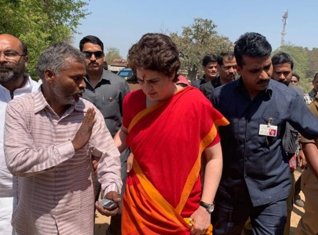Priyanka Gandhi with a Congress worker in Bhadohi.
