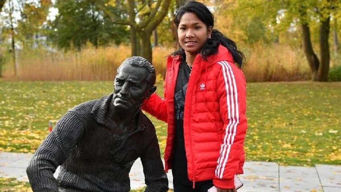 Swapna Barman seen here with the statue of Adolf Dassler, the founder of Adidas, when she visited the Athlete Services Lab in Herzogenaurach, Germany.