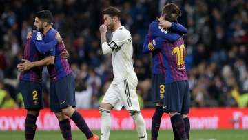 Real Madrid's Sergio Ramos walks past Barcelona players celebrating after winning the La Liga match between Real Madrid and FC Barcelona at the Bernabeu stadium in Madrid on Saturday.