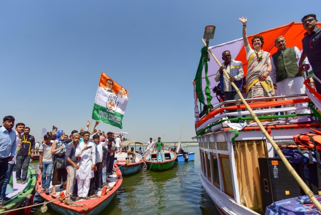 Priyanka Gandhi Vadra waves to her party supporters as she arrives at Assi Ghat, in Varanasi.